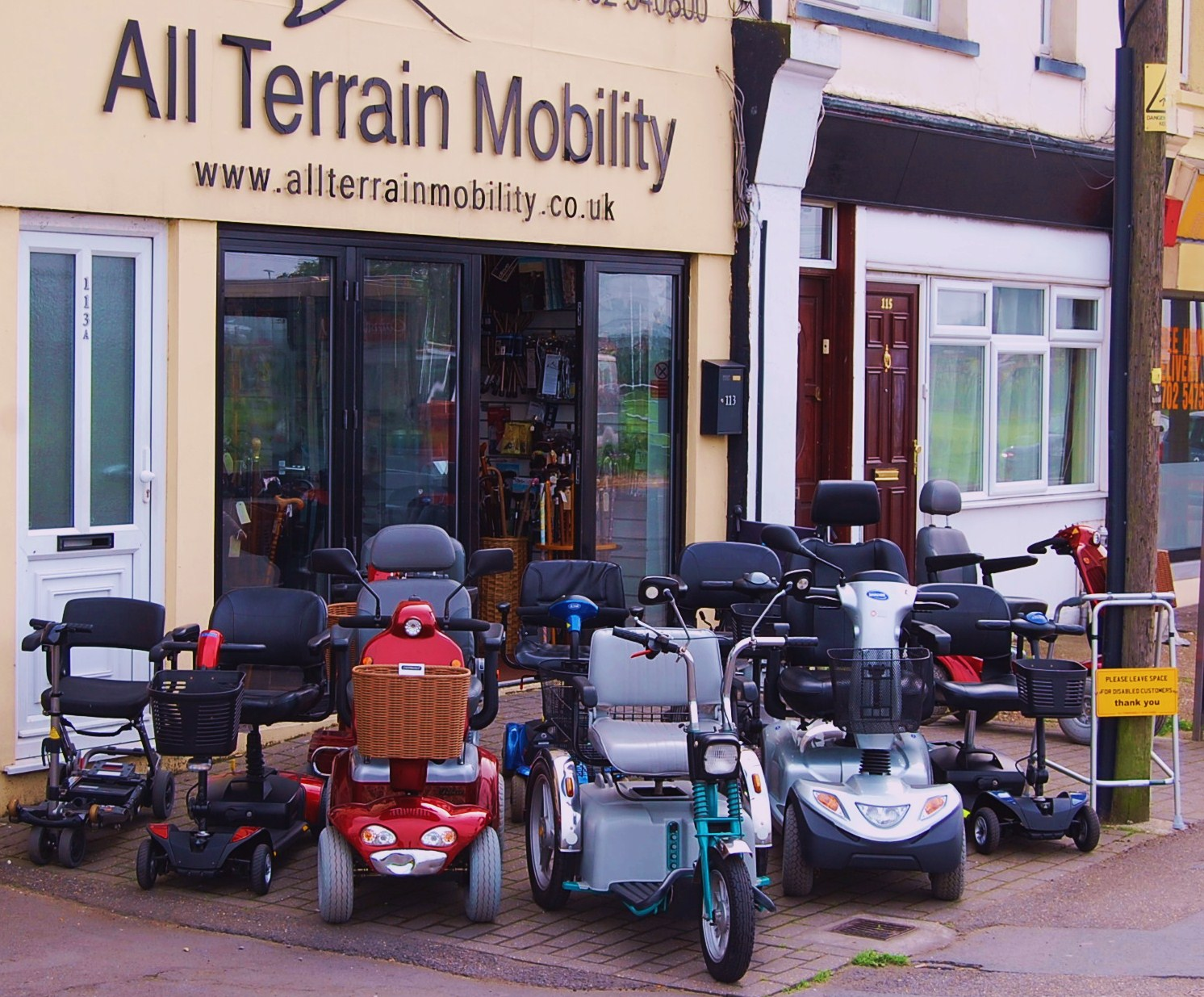 Some of our fabulous pre-loved mobility scooters on display outside the front of our shop.