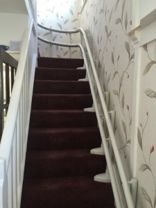 Curved stairlift picture. Tracking blends in nicely with the decor.