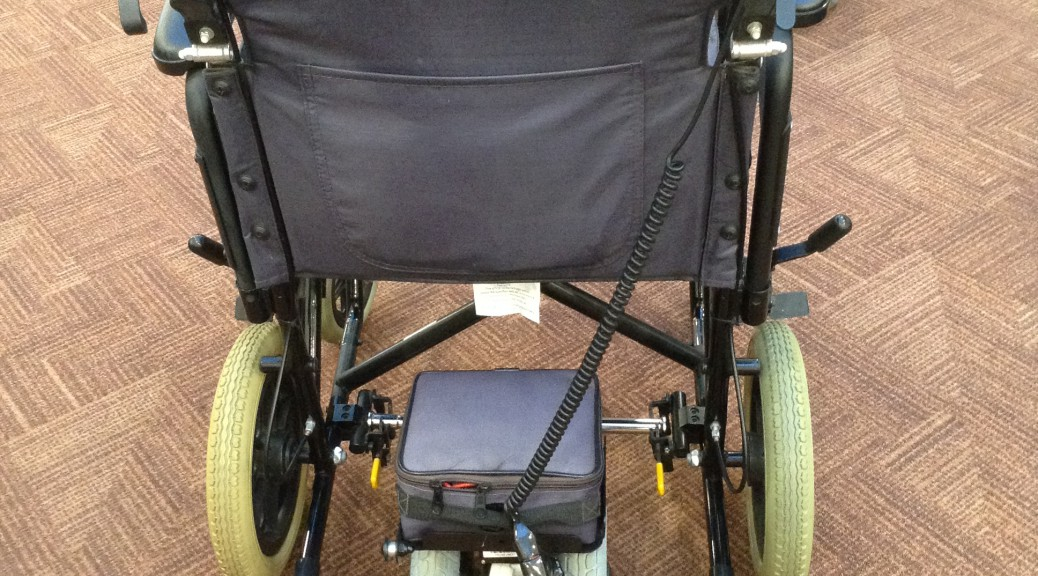 A Picture of an All Terrain Mobility wheelchair power pack fitted to a manual wheelchair.