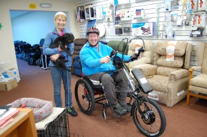 Liz (Director of All Terrain Mobility), Freddy (Small black dog) and Robin Womak (Paralympic athlete) and the All Terrain Team Hybrid Powered hand cycle!