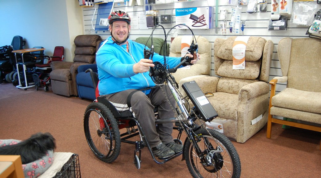 medalist Shotputter on his All Terrain Mobility Team Hybrid powered hand cycle. The hand cycle is an attachment that can be fixed to the magotiry of rigid frame manual wheelchairs in seconds turning it into a trike poweed by battery and hand pedals!