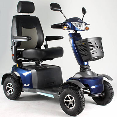 The All Terrain Mobility ATM Jupiter mobility scooter a large class 3 mobility scooter with all round suspension, four wheels, front basket, lights, indicators and mirrors, a large captains leat and plenty of style pictured in dark blue