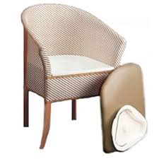 Basket weave commode - looks like a bedroom chair, wooden legs and white and cream basket weave pattern with soft seat cover and removable bucket.