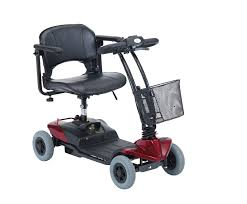 The ATM Ultralight mobility scooter in red with a delta shaped tiller, front basket, rotating seat, 4 solid wheels and removable rechargeable battery