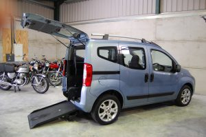 An Essex WAV's / All Terrain Mobility Fiat Qubo wheelchair accessible vehicle- with wheelchair/ mobility scooter access ramp on display in our showroom near Southend, Essex. This wheelchair accessible , WAV, mobility scooter friendly vehicle is light metallic blue