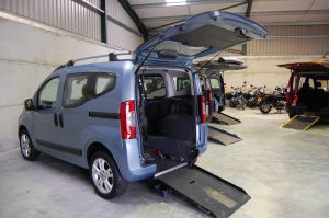 This Essex Wav's / All Terrain Mobility Fiat Qubo has a lowered floor, electric ramp and winch to allow easy access for your wheelchair / mobility scooter. This wheelchair accessible vehicle / WAV/ mobility scooter friendly vehicle has a grey interior and a top opening boot as displayed here.