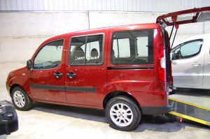 An Essex WAV's / All Terrain Mobility Fiat Doblo wheelchair accessible vehicle- with wheelchair/ mobility scooter access ramp on display in our showroom near Southend, Essex. This wheelchair accessible vehicle is Red .